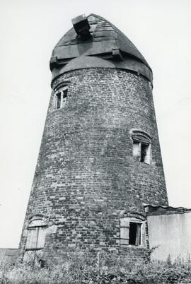 View of derelict mill with cap and no sails