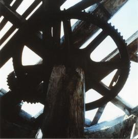 Photograph of interior machinery in an unidentified sugar mill