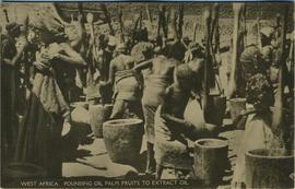 Pounding to create palm oil