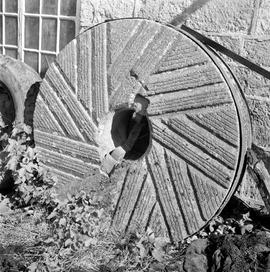 Detail view of a discarded millstone leaning against a wall, Melbury Abbas Mill, Barfoot, Shaftes...