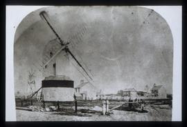 Photo of disused post mill with sweep frames and tailpole fan