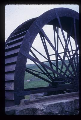 Exterior view of large waterwheel