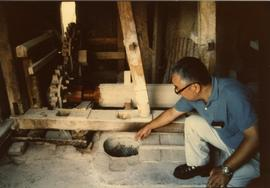 Photograph of Kenjiro Kowakami at a rice mill, Japan
