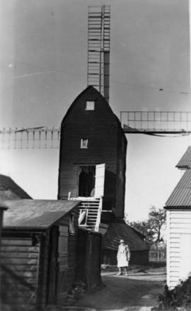 Mount Ephraim Mill, Ash, with sheds and man wearing an apron