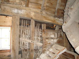 Detail of stone floor framing showing distortion of upper side girt, Six Mile Bottom Mill, Burrough Green