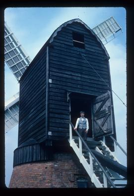 James Waterfield in doorway of buck of restored post mill