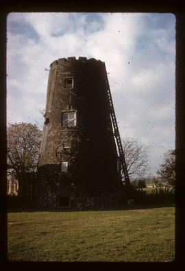 Castellated tower of tower mill with external engine drive pulley