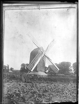 Post mill, Storrington, in working order with canvas on sails furled