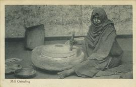 Woman mill grinding