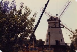 Smock mill, Upminster, with crane lifting fan stage