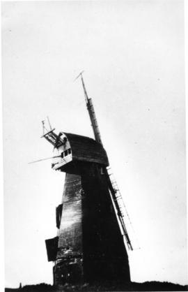 Smock mill, Pluckley, with missing fantail and only two damaged sweeps