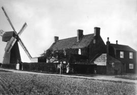 Smock mill, Chislet, and houses