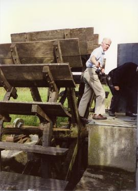 Photograph of Niall Roberts inspecting the waterwheel, Martry Mill, Meath, Ireland