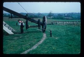 James Waterfield turning winch on tailpole to wind preserved post mill