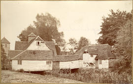 """    Mapledurham Mill, looking downstream, showing the main building and the building on the..."