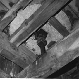 Interior of post mill showing underside of (breast) bedstone