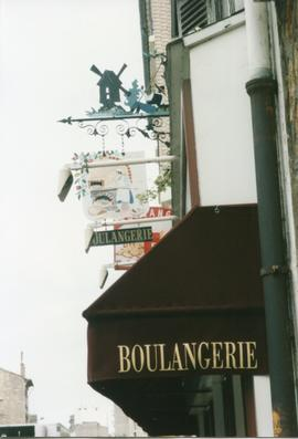 Photograph of a shop sign depicting a windmill, Clamart, France