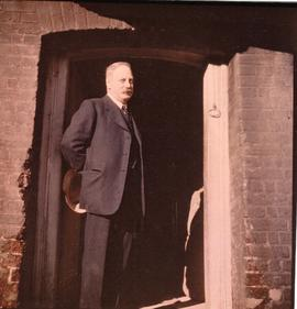 John Russell at mill door